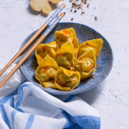 yellow seafood wonton on a blue plate